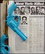 List of the dead with toy guns strung next to it