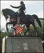 Washington statue with peace graffiti