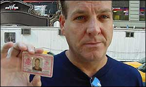 Former Marine holds his military ID