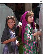 Afghan refugees queue for aid
