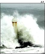 The remains of an old light house is hit by crashing waves and strong wind  in Keelung, north of Taipei