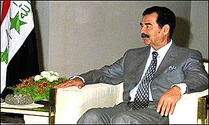 Iraqi President Saddam Hussein sits during a meeting on Tuesday