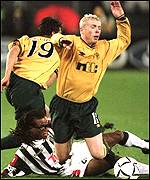 Neil Lennon is upended by Edgar Davids