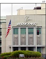 Flags at half-mast outside Boeing's former headquarters in Seattle