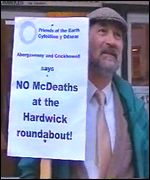 A protester outside the public inquiry