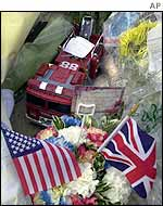 A model fire engine among the tributes at London's US Embassy