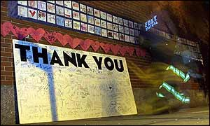 Fire-fighter walks past messages of thanks