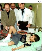 A British MP visiting injured children in an Iraqi hospital