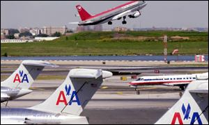 Northwest plane takes off, AA planes on ground at La Guardia airport, New York