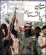 Pro-Taleban militants waving placards