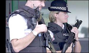 Police at Heathrow following the attacks in the US
