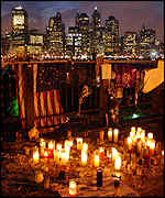 Candles against the New York skyline