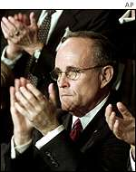 New York Mayor Rudolf Giuliani applauds Mr Bush's speech