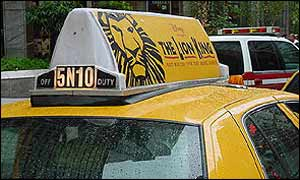 Taxi topped with show billboard