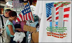 Tourist look at T-shirts commemorating the World Trade Center attacks