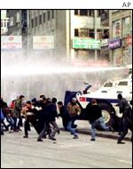 water cannon disperses the crowds