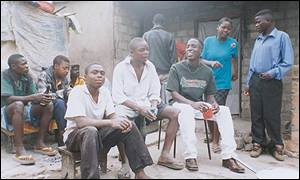 Zambian men drinking beer (image courtesy of bbc.co.uk)