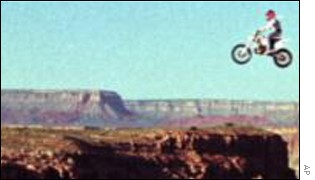 Robbie Knievel jumps the Grand Canyon on a motorbike AP