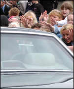 Crowds surround the prince's car
