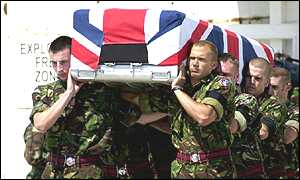 Royal Engineers carry the coffin on to a transport aircraft in Skopje