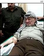 Yasser Arafat symbolically donates blood in the aftermath of the attacks on the US