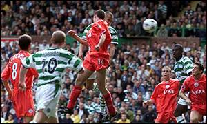 Henrik Larsson directs his header into goal
