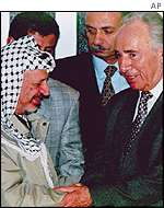 Yasser Arafat and Shimon Peres