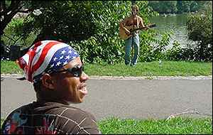 Man in park with folk singer in the background