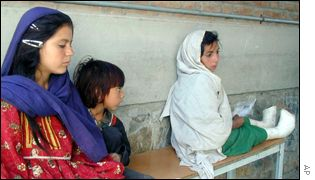 Afghan girls wait for hospital treatment in Kabul