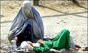 Afghan woman and sick child