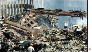 Workers clear wreckage at Ground Zero AP