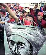 Indonesian Muslim students shout anti-US slogans with a portrait of Osama bin Laden