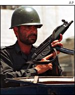 An armed Pakistani policeman