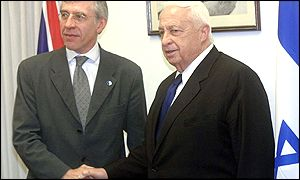 UK Foreign Secretary Jack Straw, left, shaking hands with Israeli Prime Minister Ariel Sharon
