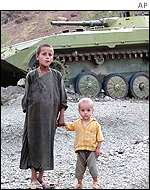Afghan children in front of an abandoned Russian tank