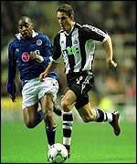Laurent Robert of Newcastle clashes with Andy Impey
