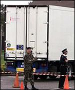 British police outside the lorry in which the men were found