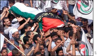 Palestinians bury one of those who died in overnight fighting