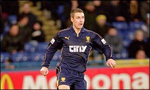 A Wimbledon FC player in action