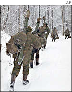 Troops trudging through snow