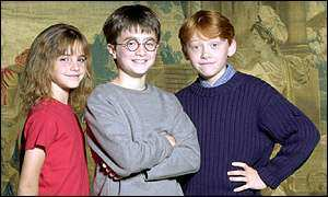 Daniel Radcliffe (centre) stars as Harry Potter