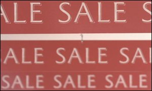 Sale signs in a shop BBC