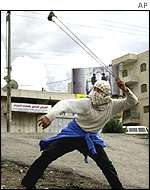 Palestinian youth slinging stones