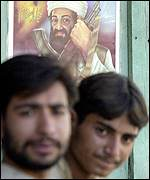 Shopkeepers in Quetta with poster supporting Bin Laden