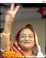 Bangladesh's former Prime Minister Sheikh Hasina shows a victory sign during an election rally