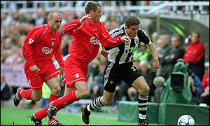 Liverpool's Jamie Carragher gets a challenge in on Newcastle's Laurent Robert
