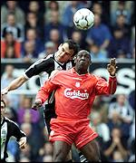 Newcastle's Nikos Dabizas gets above Liverpool striker Emile Heskey