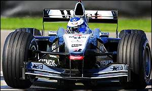 Hakkinen held off a late challenge from Barrichello