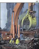 Workers clear rubble at ground zero