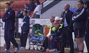 John Philliben (far right) was in charge of Motherwell at McDiarmid Park